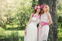 Portrait of a bridesmaid in nature. Portrait of a bridesmaid in a retro style Royalty Free Stock Photo