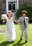 Portrait Of Bridesmaid With Page Boy Royalty Free Stock Photos