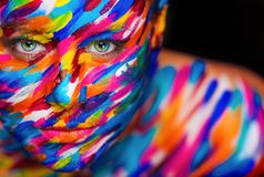 Portrait of the bright beautiful girl with art colorful make-up and bodyart royalty free stock photos