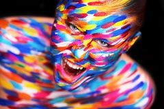 Portrait of the bright beautiful girl with art colorful make-up and bodyart royalty free stock images