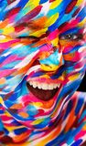 Portrait of the bright beautiful girl with painting art colorful make-up on face and bodyart. Creative vertical ads Royalty Free Stock Image
