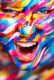 Portrait of the bright beautiful girl with painting art colorful make-up on face and bodyart. Creative vertical ads Royalty Free Stock Photo