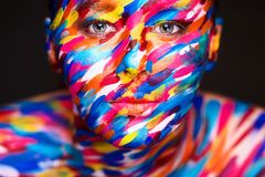 Portrait of the bright beautiful girl with art colorful make-up and bodyart royalty free stock photo