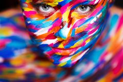 Portrait of the bright beautiful girl with art colorful make-up and bodyart stock images