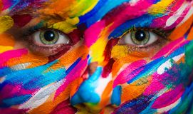 Portrait of the bright beautiful girl with art colorful make-up and bodyart royalty free stock photography