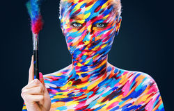 Portrait of the bright beautiful girl with art colorful make-up and bodyart Stock Photos