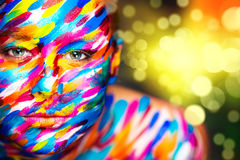 Portrait of the bright beautiful girl with art. Portrait of the bright beautiful emotional woman with art make-up Stock Photos