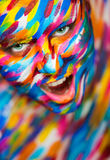 Portrait of the bright beautiful girl with art. Portrait of the bright beautiful emotional woman with art make-up stock photo