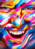 Portrait of the bright beautiful girl with painting art colorful make-up on face and bodyart. Creative vertical ads Royalty Free Stock Photos