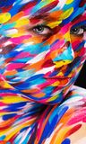 Portrait of the bright beautiful girl with painting art colorful make-up on face and bodyart. Creative vertical ads Royalty Free Stock Photography