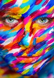 Portrait of the bright beautiful girl with painting art colorful make-up on face and bodyart. Creative vertical ads Royalty Free Stock Images