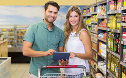 Portrait of bright couple using digital tablet Royalty Free Stock Images