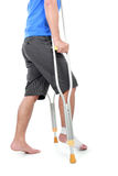 Portrait of a broken foot using crutch Stock Photo