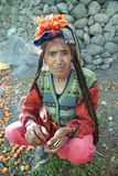 Portrait of Brokpa / Drokpa elderly woman in Dha Hanu, India. Portrait of elderly woman belonging to Drokpa or Brokpa tribe in traditional head covering and Royalty Free Stock Images