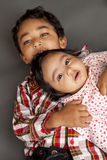 Portrait of Brother and Newborn Sister. Portrait of Brother holding his newborn baby sister stock photography
