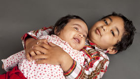 Portrait of Brother and Newborn Sister. Portrait of Brother holding his newborn baby sister royalty free stock photo