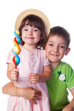 Portrait of a brother and sister with candy. Studio shot royalty free stock photos