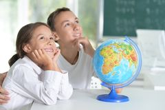 Brother and sister doing homework Royalty Free Stock Images