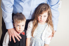 Portrait of brother and sister held by a father Royalty Free Stock Image