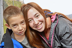 Portrait of brother and sister hugging in a cable car Royalty Free Stock Image