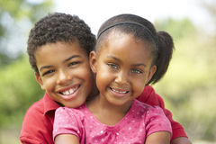 Portrait Of Brother And Sister In Park Stock Photography