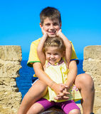 Portrait of brother and sister smiling under the sun Royalty Free Stock Photography