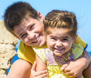 Portrait of brother and sister smiling under the sun Stock Images