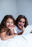 Portrait of brother and sister using digital tablet Royalty Free Stock Image