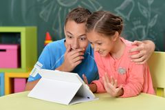 Portrait of brother and sister using tablet royalty free stock photo