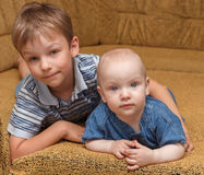 Portrait of the brothers. Children pose lying on a sofa Stock Images