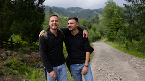 Portrait of brothers of tourists in the mountains.  stock footage