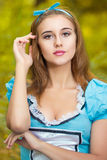 Portrait of brown-haired girl. In a suit in the nature of Alice in Wonderland Stock Images