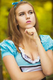 Portrait of brown-haired girl. In a suit in the nature of Alice in Wonderland Stock Photography
