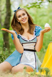 Portrait of brown-haired girl. In a suit in the nature of Alice in Wonderland tea party on Stock Images