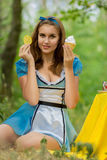 Portrait of brown-haired girl. In a suit in the nature of Alice in Wonderland tea party on Stock Photography