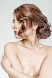Portrait of brown-haired romantic girl with naked back Royalty Free Stock Photo