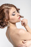Portrait of brown-haired romantic girl with naked back Royalty Free Stock Image