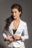 Portrait of brunette beautiful girl posing in white dress royalty free stock image