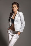 Portrait of brunette beautiful girl posing in white dress stock images