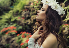 Portrait of a brunette beauty in a tropical garden Stock Photography