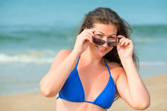 Portrait of a brunette in a blue bathing suit Stock Image