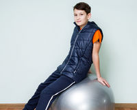 Portrait of a brunette boy on a fitball Royalty Free Stock Photos