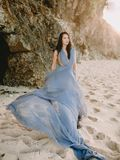 Portrait of brunette bride in blue wedding dress at beach with sunset colors. Portrait of bride in blue wedding dress at beach with sunset or sunrise Stock Images