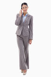Portrait of a brunette businesswoman making a phone call Stock Photography