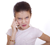 Portrait of brunette Caucasian schoolgirl calling by phone Stock Photo