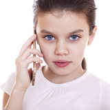 Portrait of brunette Caucasian schoolgirl calling by phone Royalty Free Stock Images