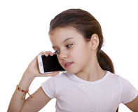 Portrait of brunette Caucasian schoolgirl calling by phone Stock Photos