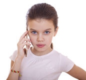 Portrait of brunette Caucasian schoolgirl calling by phone Stock Image