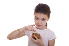 Portrait of brunette Caucasian schoolgirl with mobile phone Stock Photos