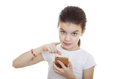 Portrait of brunette Caucasian schoolgirl with mobile phone Royalty Free Stock Image